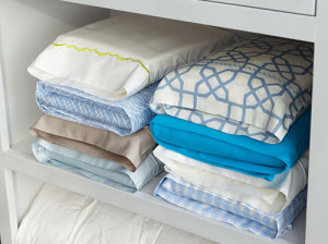 Store sheet sets inside pillowcases