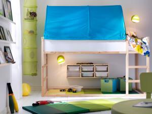 Ikea Kuru reverisble bed set up to create a small play and storage area.